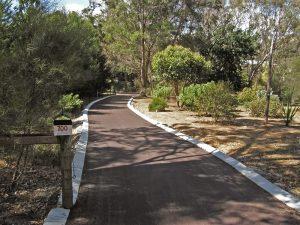 Residential red asphalt driveway in Parkerville