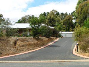 Residential asphalt driveway by NK Asphalt