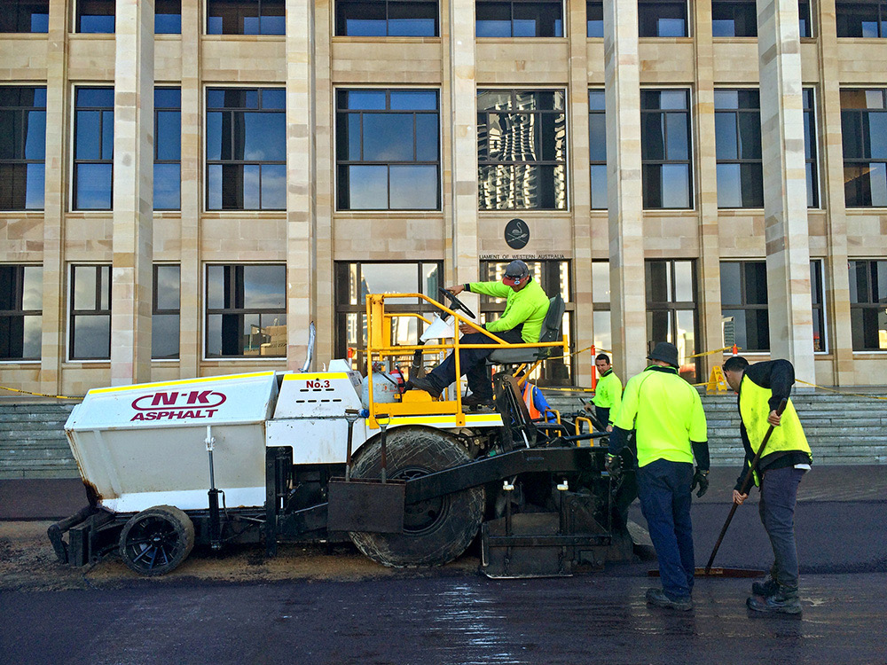 NK Asphalt team resurfacing outside Parliament House