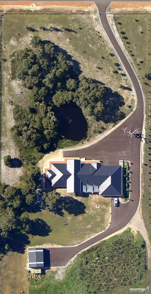 Aerial view of resurfaced rural driveways by NK Asphalt in Brabham